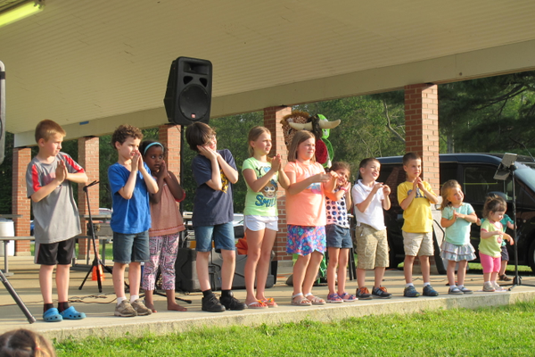 Kids follow along with Johnny the K during the Family Concert performance at Livingston Street.