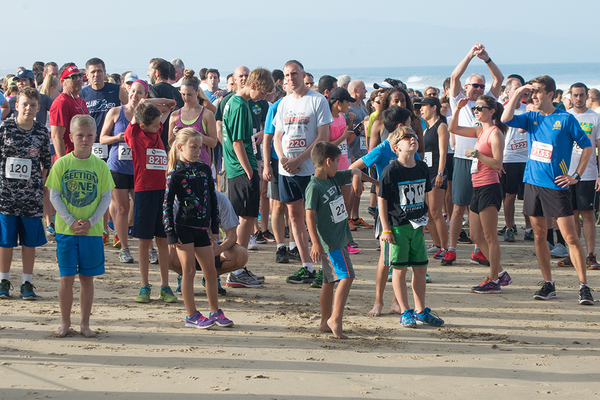 Runners get ready for the start of the Manhattan Beach 5K, with youngsters pushed to the front.