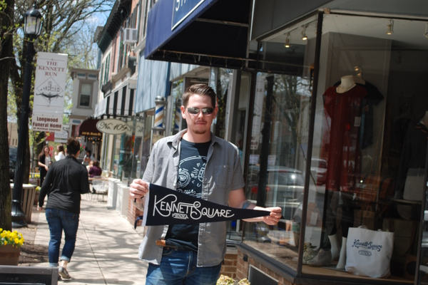 Dan McShane designed a line of Kennett Square pennants and tote bags which are sold at State and Union.