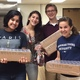 Marisa Maxwell Kavya Shetty Olivia Pagliaro and Ben Skross prepare bags of snacks for students at the Mary D Lang Kindergarten Center