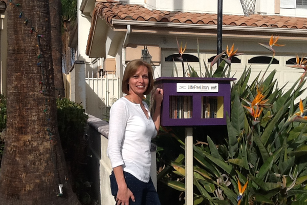 Chris Primm stands by her Little Free Library in Manhattan Beach
