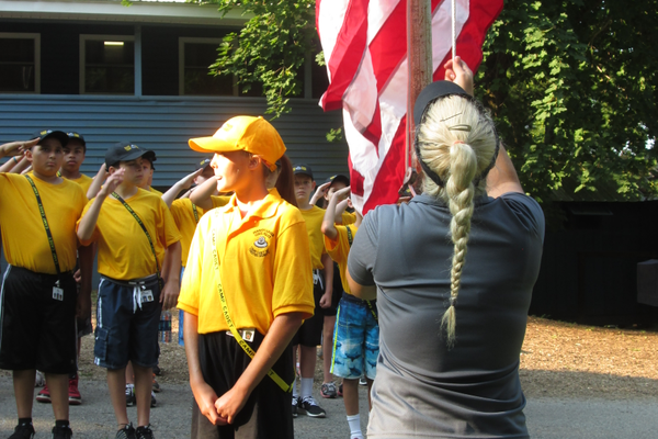 The flag-raising ceremony is held each morning at Camp Saginaw near Oxford.