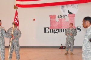 Texas Army National guardsmen Capt Eric Leatherman center the outgoing commander of the 454th Engineer Company speaks to personnel during the units change of command ceremony at the National Guard Armory in San Angelo Texas July 19 2015 The 454th adopted the lonewolf insignia and is a Route Clearance Company under the 111th Engineer Battalion 176th Engineer Brigade Texas National Guard photo by Capt Maria MengroneReleased courtesy of Defense Videos  Imagery Distribution System