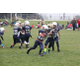 Tiny Mite Nolan Robertson carrying the ball for a twenty-two yard gain.