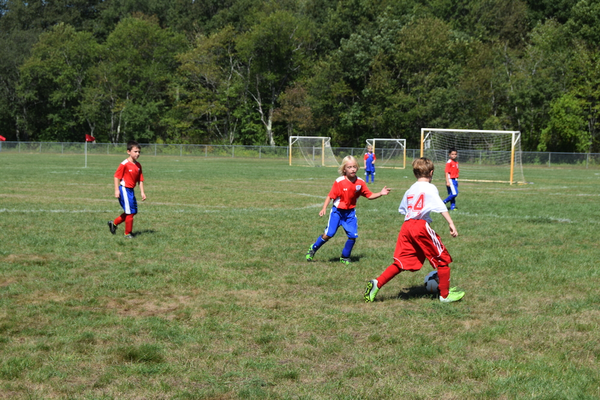 The Tewksbury U10 Boys soccer team did battle with Melrose on Saturday under sunny skies at the Frasca Fields complex.