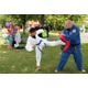 Jeff Farquhar sidekicks targeting pad held by Northeastern Tae Kwon Do Academy Chief Instructor Keith McLinden.