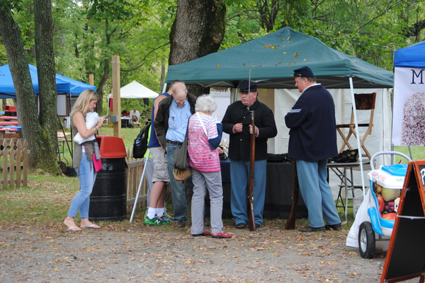 Reenactors offered explanations about their weapons and their dress to the visitors.