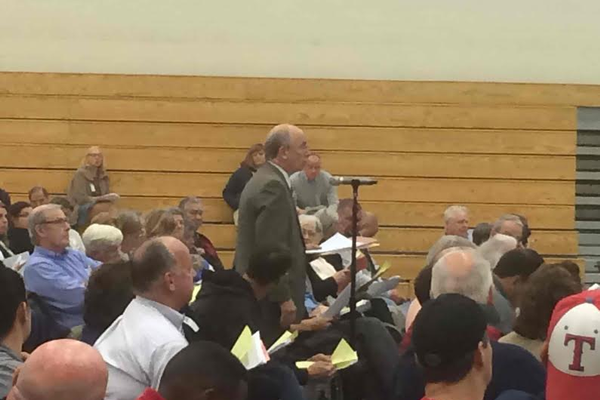 A resident speaks on an article at the Special Town Meeting.
