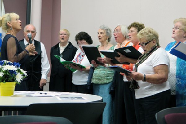 Linda Trudeau (left) leads members of the Bellingham Senior Community Chorus