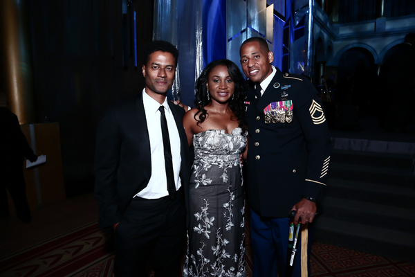 Master Sergeant Cedric King and his wife Khieda King, with Grammy-nominated artist Eric Benét