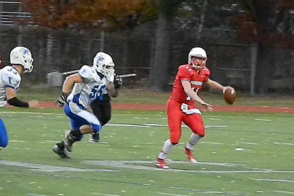 Brett Morris (11) compleed 9-of-14 passes for 120 yards against Danvers.