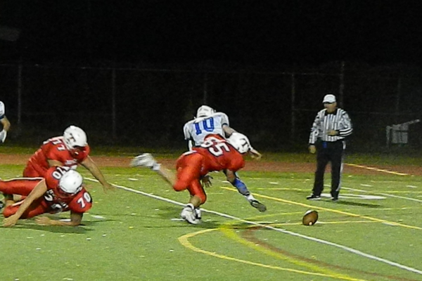 Senior defensive lineman Mark gorman (65) sacks Danvers QB Matt Andreas.