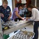 Heid Preston, Stephanie Smerdon and Dr. Lesser prepare Luna the cat for dental surgery.