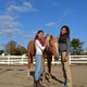 Marlena Awitan left and Sabina Carbaugh along with Guy one of the horses used during therapy sessions at Healing with Horses Inc at Carousel Park