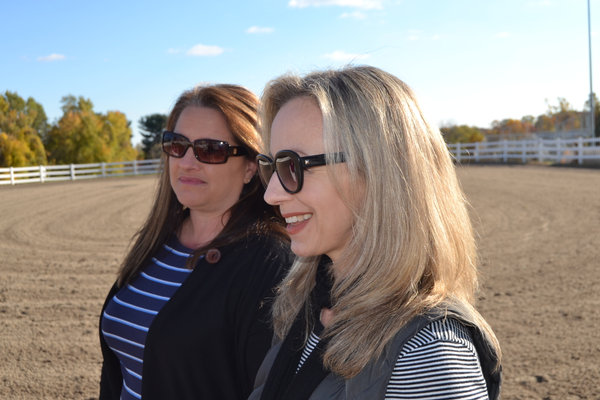 Equine therapist Maryellen Carbaugh, along with equine specialist Leah Awitan, at the riding arena at Healing with Horses, Inc.
