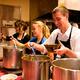 Student volunteers serve soup