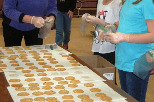 Two fresh cookies per bag were counted out by Hillendale students.