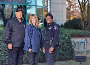ACAPP President Charles Richardson Treasurer Frederikka Freddy Stark and Arlington Police Officer Kimberly Fretwell