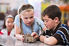 Kids examine rocks
