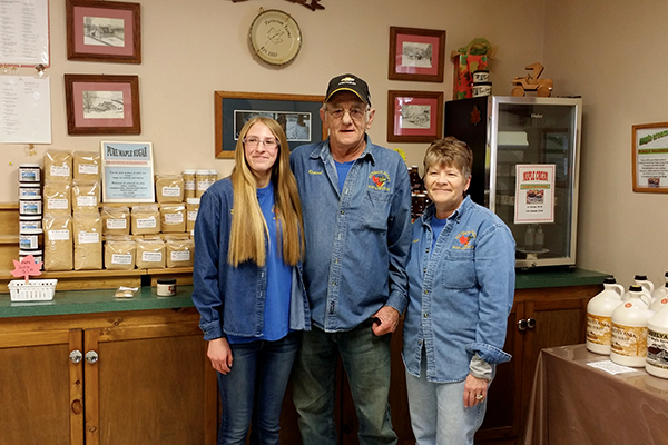 Danielle Wanner, Richard Patterson and Linda Neal of Patterson Farms. Danielle is Richard's granddaughter and is carrying on the maple-producing tradition.