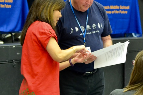 MBMS Principal John Jackson confers with a volunteer