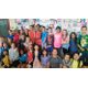 Draper Elementary students pose in front of the mural they created.—Kelly Cannon