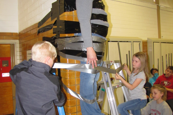 On March 23, Viewmont students took turns applying strips of duct tape to hold their principal, Missy Hamilton, to the wall as a reward for reaching their first goal with Pennies for Patients, Leukemia & Lymphoma Society's fundraiser. — Julie Slama