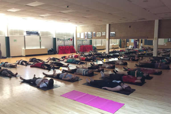 Fifty Hillcrest High School students lay in 'Resting Pose' to begin their yoga practice. This is the first year yoga has been offered as a physical education elective at Hillcrest.