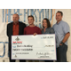 Dallin Bentley, varsity lacrosse captain at Bingham High School, poses for a picture with a big fake check, his parents and a Footlocker representative after being awarded a $20,000 scholarship. – Tori La Rue