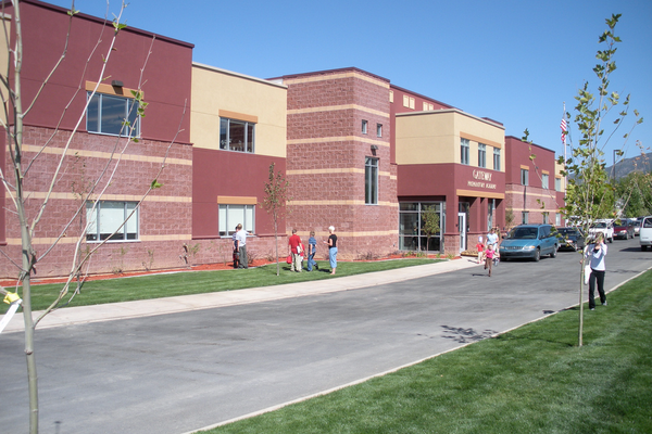 The exterior of the Gateway Preparatory Academy in Enoch, Utah, as parents pick up their kids from school. Glenn Hileman said HighMark has built schools in 16 different states. —HighMark