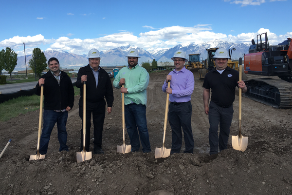 The owners of Taffy Town, all relatives, pose for a picture at the ground breaking of their new facility on May 10.  –Tori La Rue