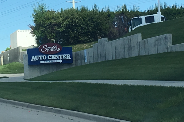 Pictured is a sign for South Jordan's Auto Center. West Jordan has never seen a dealership within its bounds, but city staff hopes to have auto center in the future. – Tori La Rue