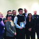 """Trevor VanRoosendall, of Riverton High School, holds his """"Student of the Year"""" plaque, surrounded by his family, principal, mayor, president of the local Footprinters chapter and the officer who nominated him for the award. –Tori La Rue"""