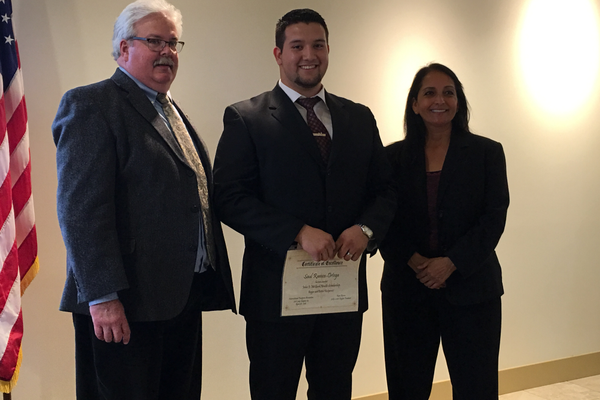 Representatives from the Footprinters association stand with high schooler Saul Ramos-Ortega, who they awarded a $300 scholarship. –Tori La Rue