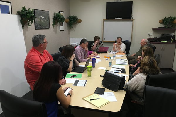 The committee for WestFest prepare for the annual celebration during a meeting. WestFest will take place at Centennial Park from June 16-19. – Kevin Conde