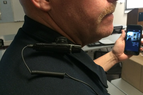 The body camera can be worn on the shoulder as well with camera images appearing on the phone in the officer's hand. – West Valley City Police Department