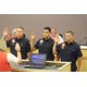 New-hires Braydon Cannon, Carlos Lopez, and Jared Thomas taking their oath to become firefighter/EMTs on June 28, 2016. (Photo: Chris Larson, Sandy City Journal)