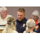 Fire department new-hire Braydon Cannon was his badge presented to him by his wife, Bailey Cannon during the swearing-in ceremony at the Sandy City Council Chambers on June 28, 2016. (Photo: Chris Larson, Sandy City Journal)