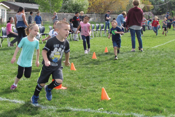 Copperview Elementary students ran in the school's annual fun run on April 22 before picking up litter on the school grounds as part of Earth Day. —Julie Slama