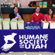 """Jamie Ortwein, Ricardo the cat, Dash Anderson and Savanna Fluter assist at the book signing for Wayne Pacelle's new book, """"The Humane Economy."""""""