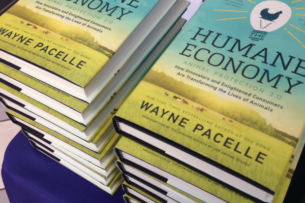 "New York Times bestselling author Wayne Pacelle's new book, ""The Humane Economy,"" sits ready for signing."