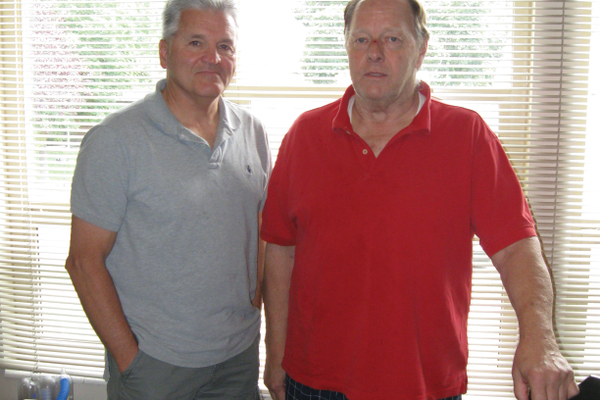 Tom Roberson (left) stands next to friend and neighbor Jim Knutson a few weeks after Knutson went into cardiac arrest during church. Roberson, along with three others, worked fast using chest compressions and an automatic external defibrillator to save Knutson's life. —Travis Barton