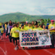 South Jordan Elementary students carry a banner at the parade May 20 during the Jordan School District Sports Day. — Julie Slama