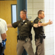 Utah Highway Patrol's Sgt. Andrew Prescott, left, and Trooper Scott Attridge, right, explain covering a four-way hallway with a two-member contact squad at Jordan High School on July 5, 2016. (Photo: Chris Larson, Sandy City Journal)