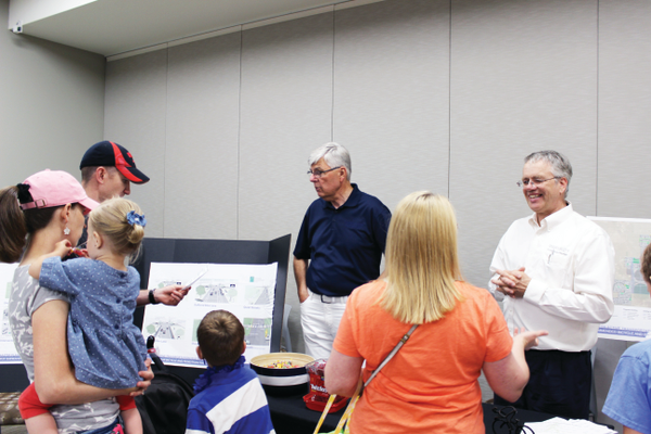 Mayor Bill Applegarth and Councilmember Paul Wayman inform residents of Riverton's Active Transportation Plan on June 11. Photo courtesy of Briana Kelley.