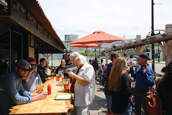 Participants in the 2nd Annual Sugar House Pub Crawl drink beer on the patio on Saturday, May 21. – Jeremy Higginson