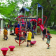 Kids rushed the playground at the end of the ceremony to play on its structures. —Travis Barton