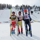 Pat Arnone, Tim Magill and Marsh Gooding finish an afternoon of Gelandesprung ski jumping during the 103rd winter carnival. Photo by Suzi Mitchell.