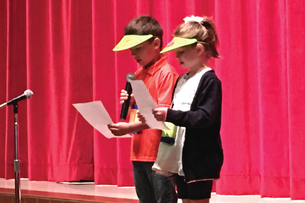 Arcadia Elementary School students sing while dressed as ninja spiders during a performance of their self-written opera. – Tori La Rue