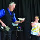 Mike Hamilton, magician, performs magic tricks at Salt Lake County Library Service's summer reading challenge kick-off event. – Salt Lake County Library Services